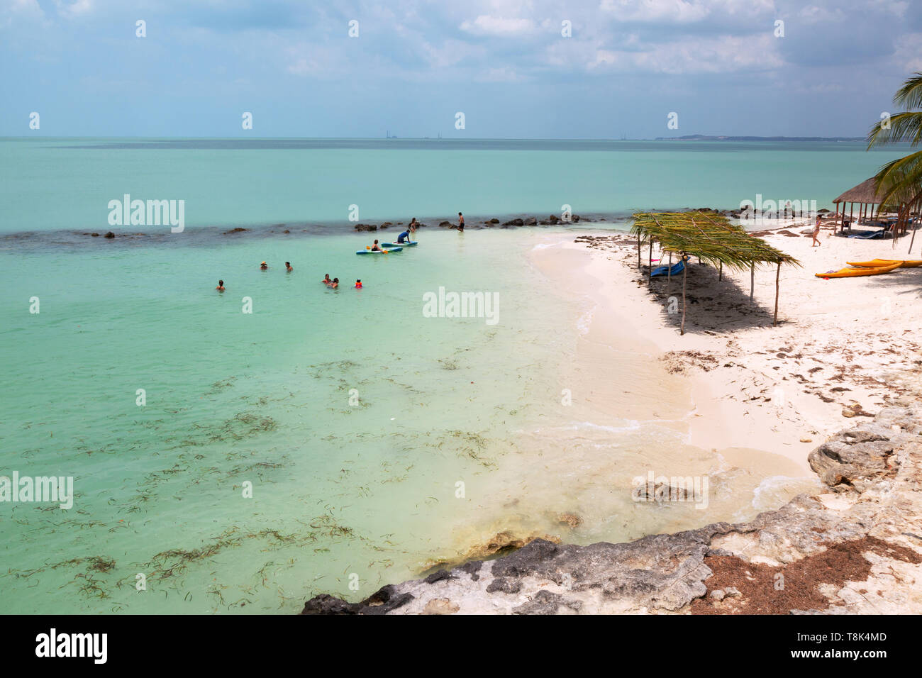 Mexico beach - tourists on holiday on the beach at Campeche, Yucatan, Mexico, Gulf of Mexico, Stock Photo