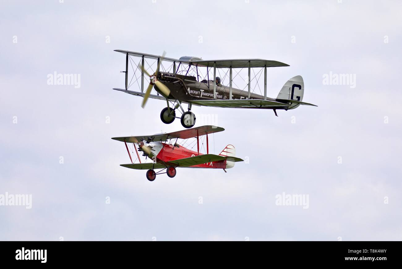 1924 de Havilland DH.51 'MISS KENYA' flying in formation with a 1929 Southern Martlet at the season premiere at Shuttleworth on the 5th May 2019 - Stock Image