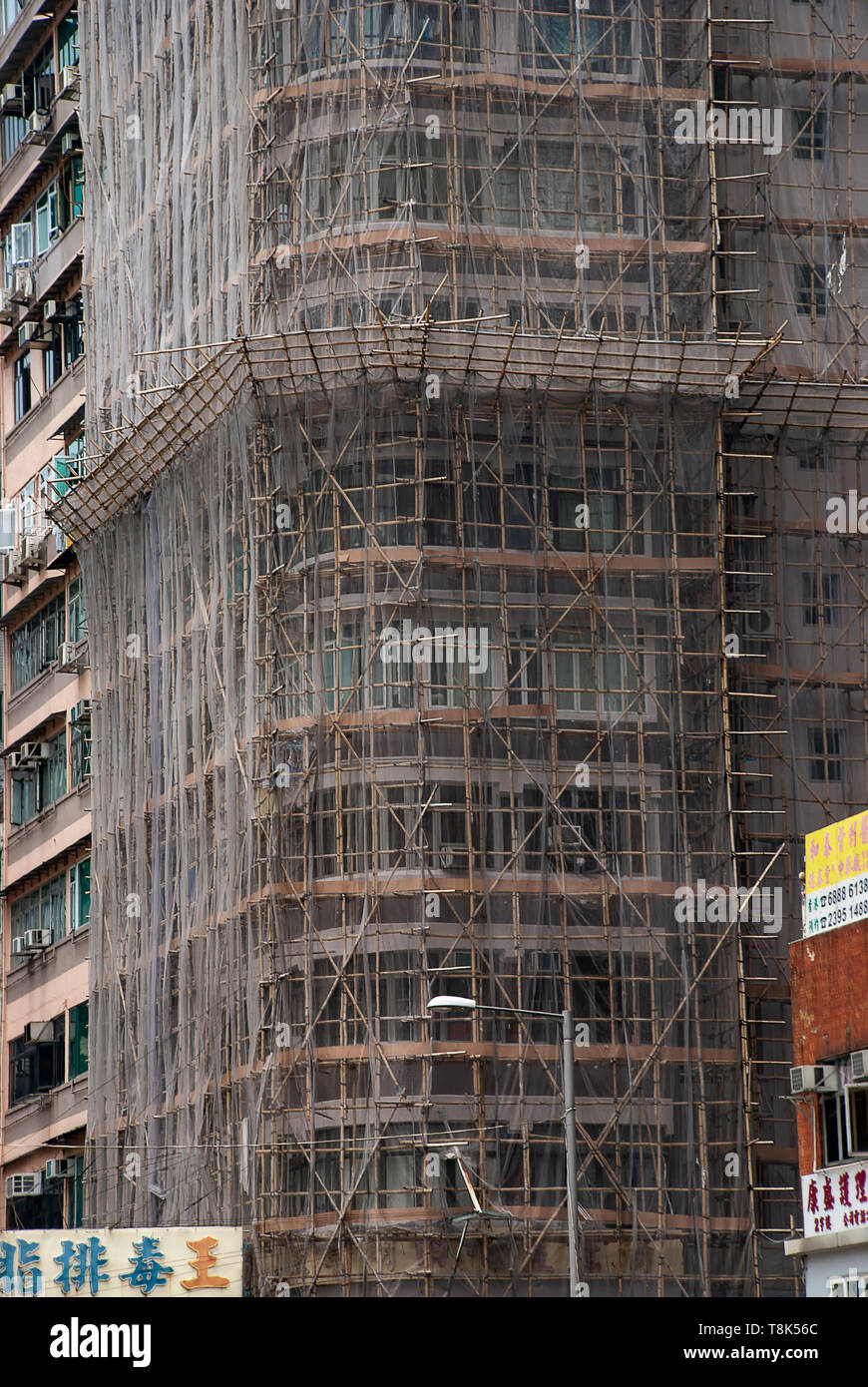 Bamboo scaffolding has been used in Hong Kong since the 1800s and can still be seen in the city today - Stock Image