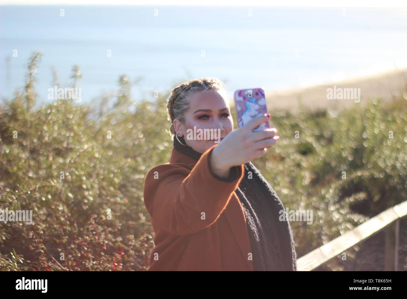Beautiful lady taking selfie - Stock Image