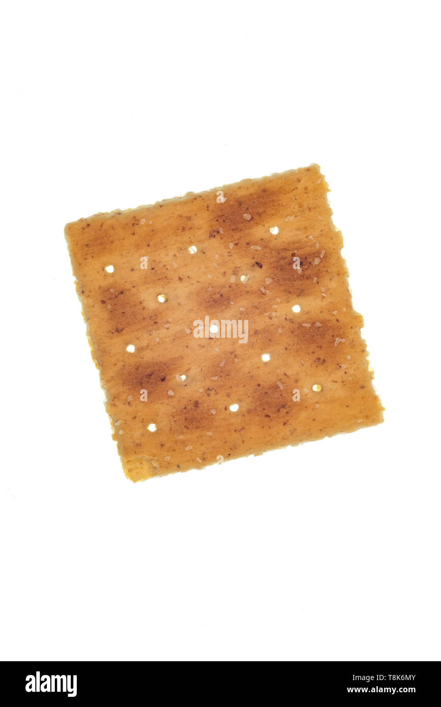 Vertical shot of a single whole-wheat cracker isolated on white. - Stock Image