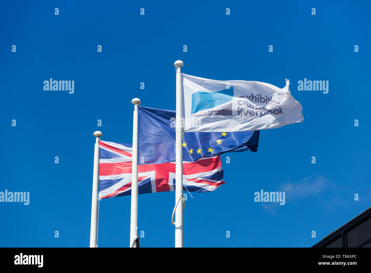 Union Jack and European Union flags flying outside the Liverpool Exhibition Centre on Kings Dock Liverpool, part of The ACC Liverpool Group. - Stock Image