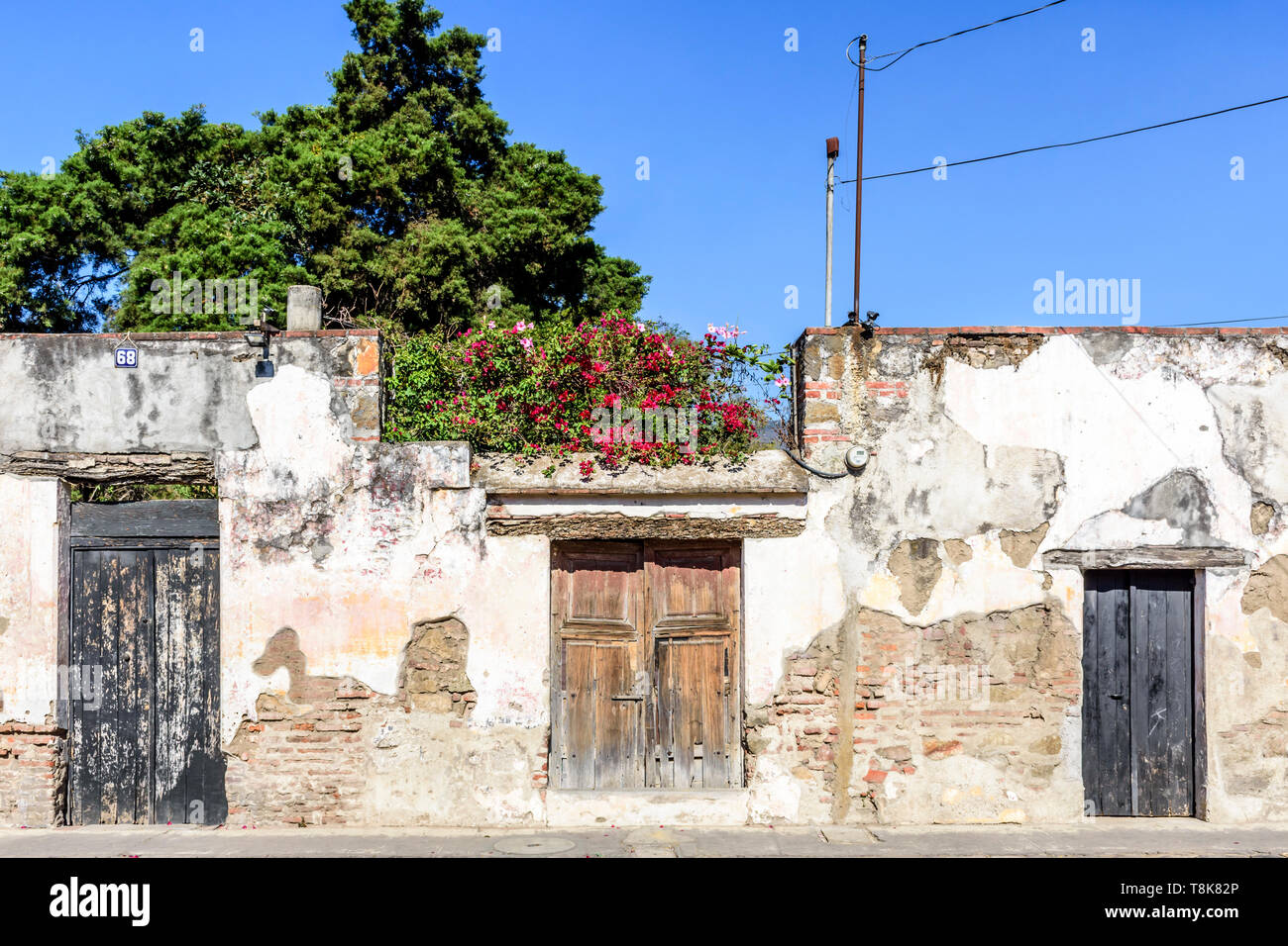 Antigua, Guatemala - April 14, 2019: Old crumbling ruined wall in colonial city & UNESCO World Heritage Site of Antigua. - Stock Image