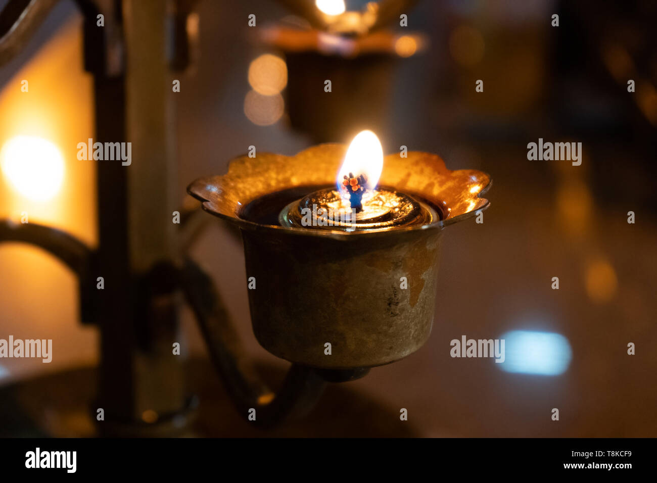 oil lamp at buddhist monastry - Stock Image