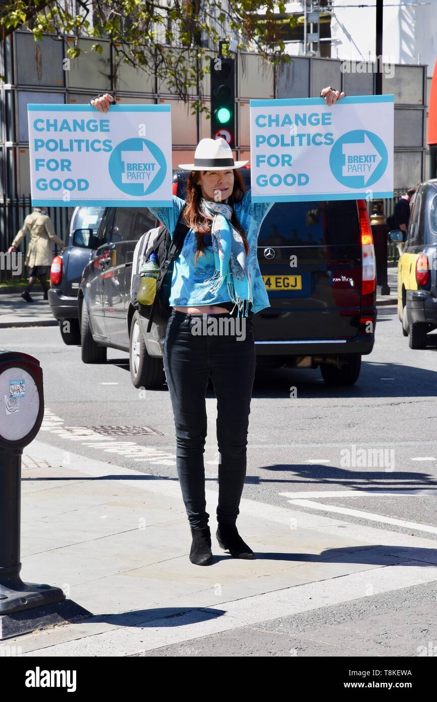 A Brexiteer promotes the Brexit Party in Parliament Square, London Stock Photo