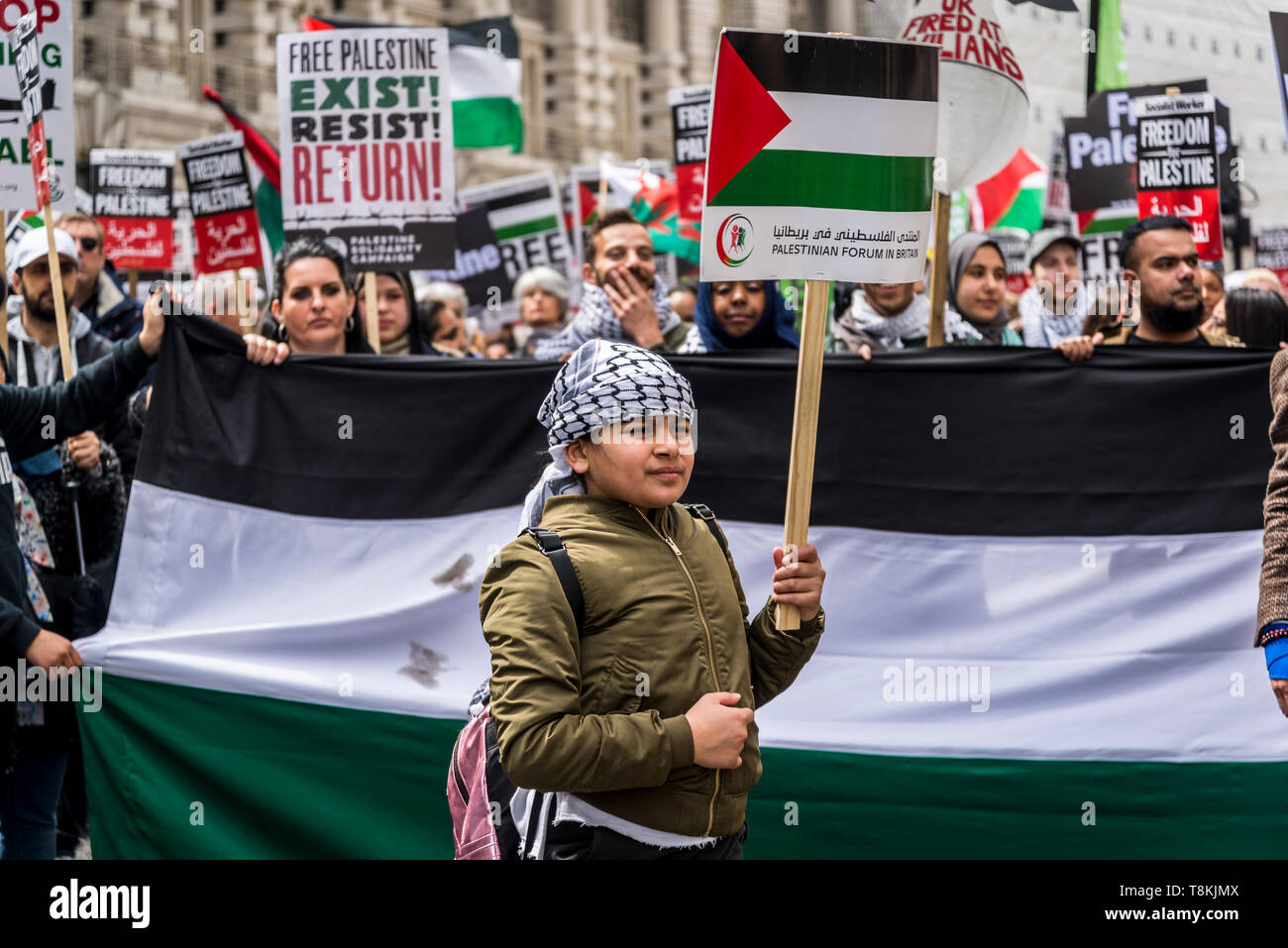 National Demonstration for Palestine, Nine year old Palestinian girl carrying a banner, London, UK 11/05/2019 - Stock Image