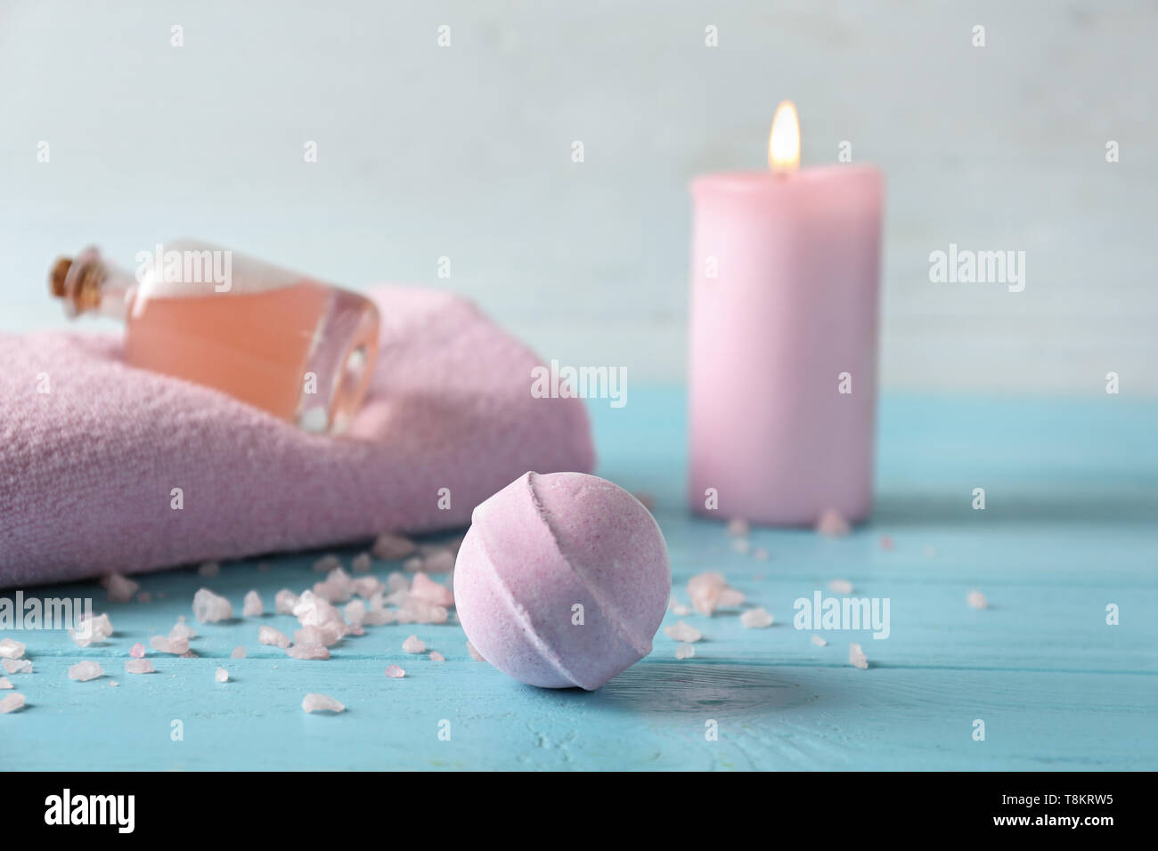 Spa composition with bath bomb on color table - Stock Image