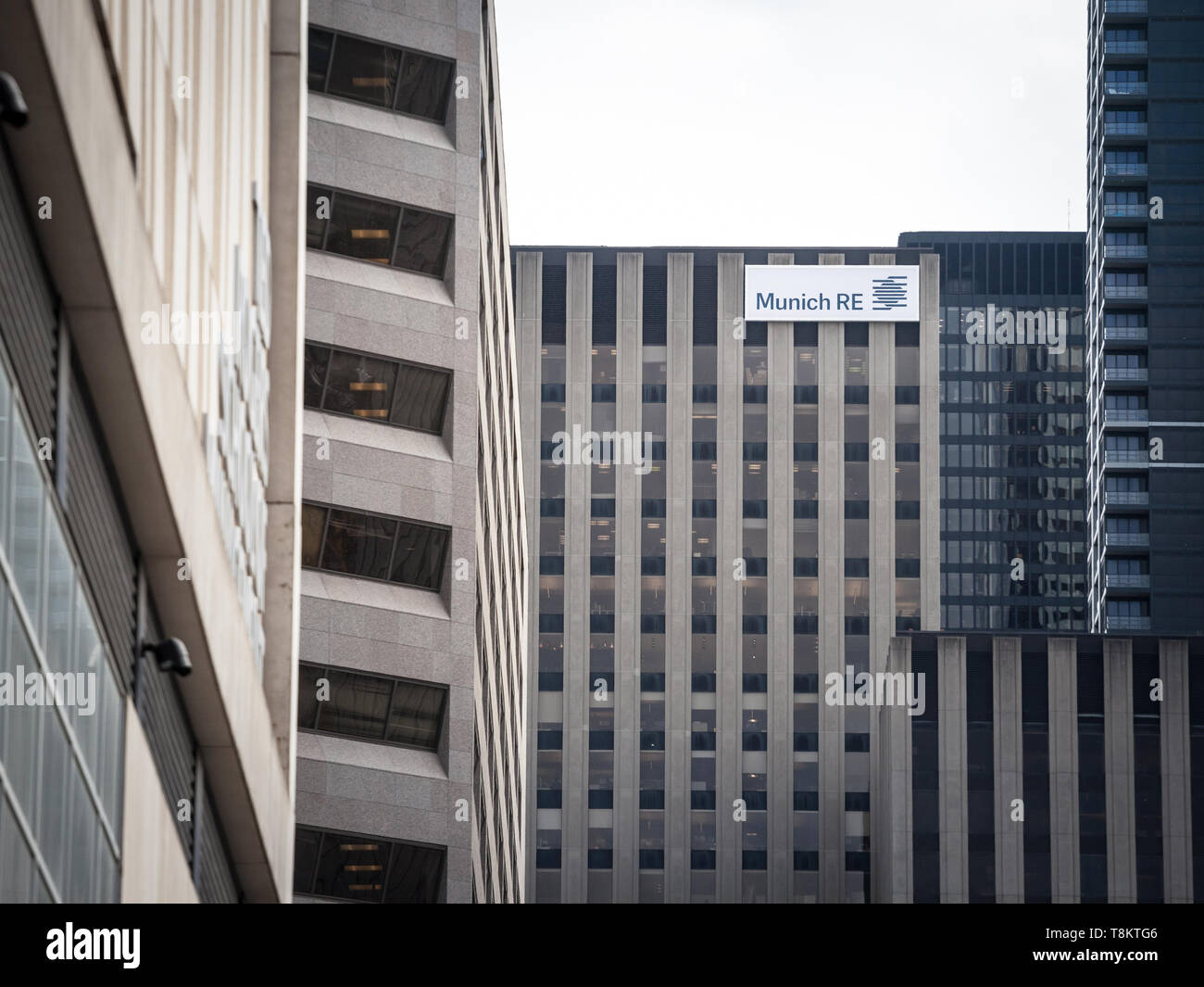 TORONTO, CANADA - NOVEMBER 13, 2018: Munich RE logo, on of their headquarters for Canada in Toronto, Ontario. Munich RE, or Munchener Ruck, is a Germa - Stock Image