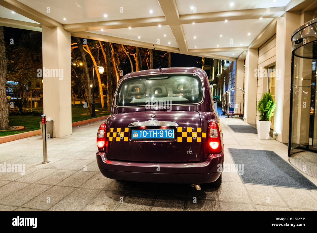 Baku, Azerbaijan - May 1, 2019: Rear view of traditional Azeri taxi cab hackney carriage taxi in front of Hyatt luxury five star hotel in Baku - Stock Image
