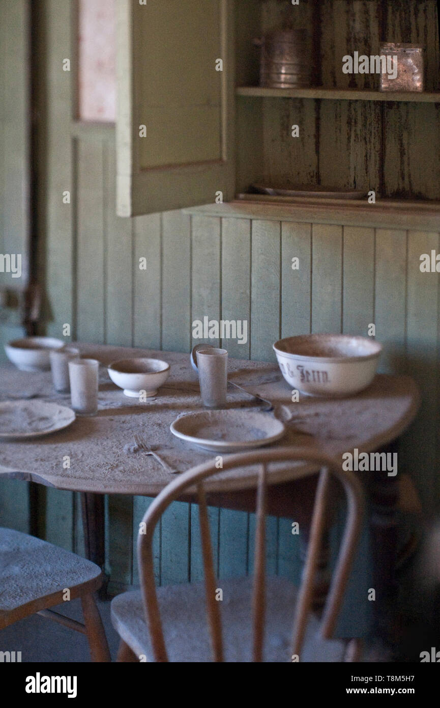 Dining Table in Abandoned Home - Stock Image