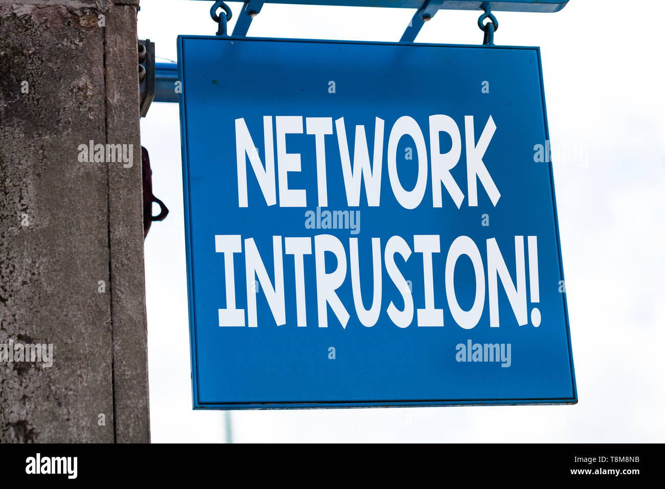 Writing note showing Network Intrusion. Business concept for device or software application that monitors a network - Stock Image