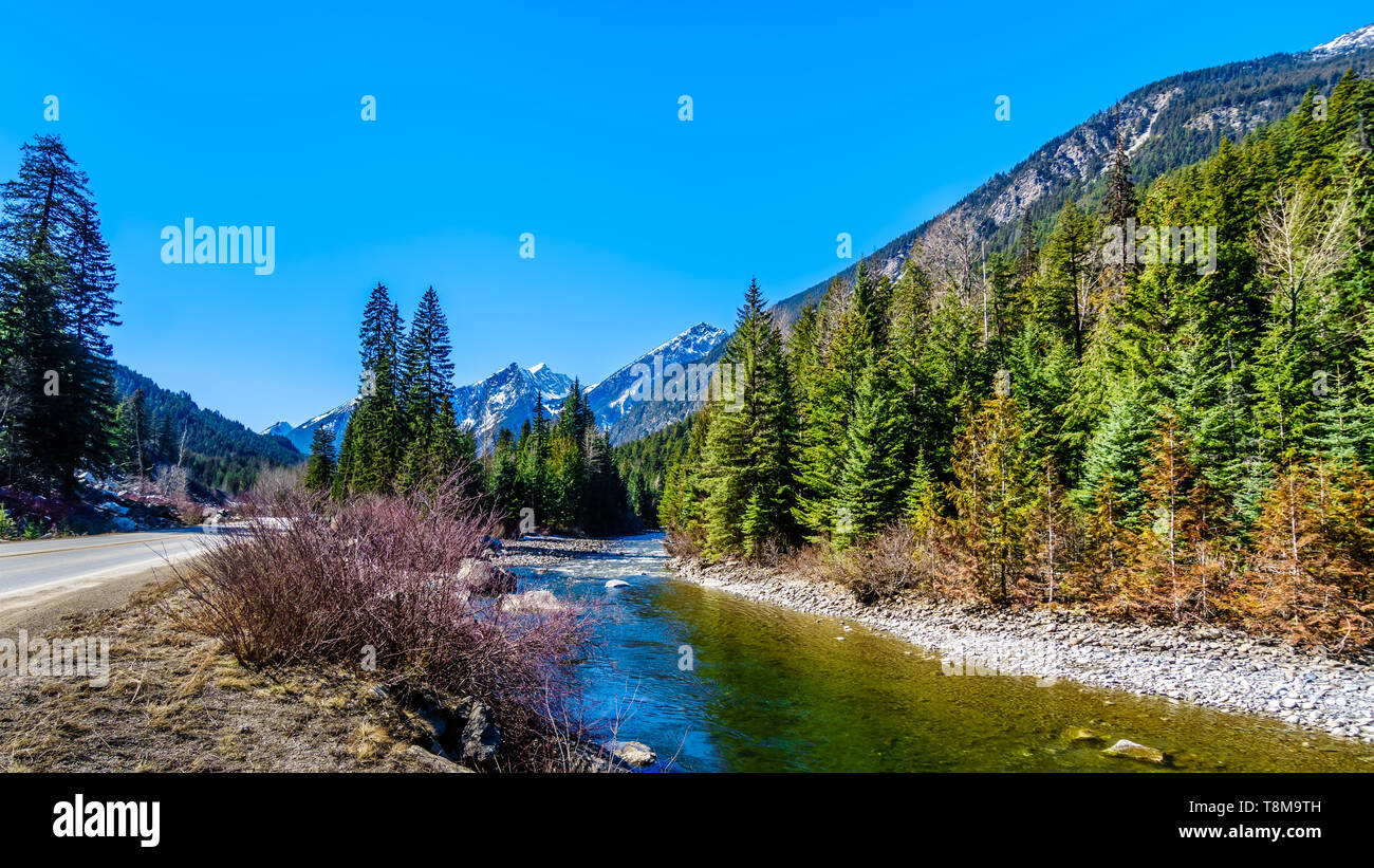 The snow capped Coast Mountains along Highway 99, the Duffey Lake Road, winding through the Coast Mountain Range between Pemberton and Lilloet in BC Stock Photo