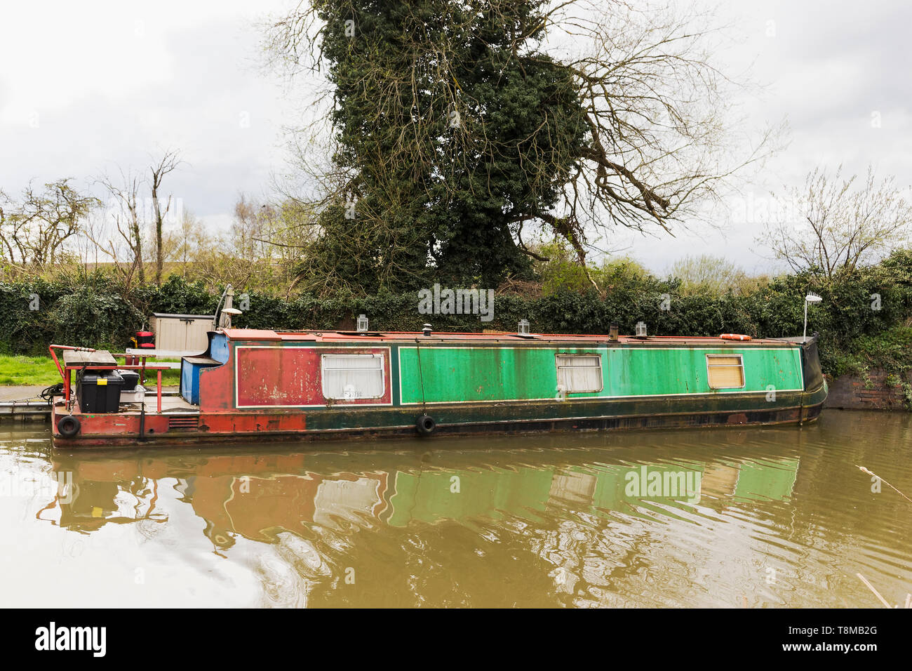 Longboat on a canal at Stratford upon Avon possibly in need of renovation - Stock Image