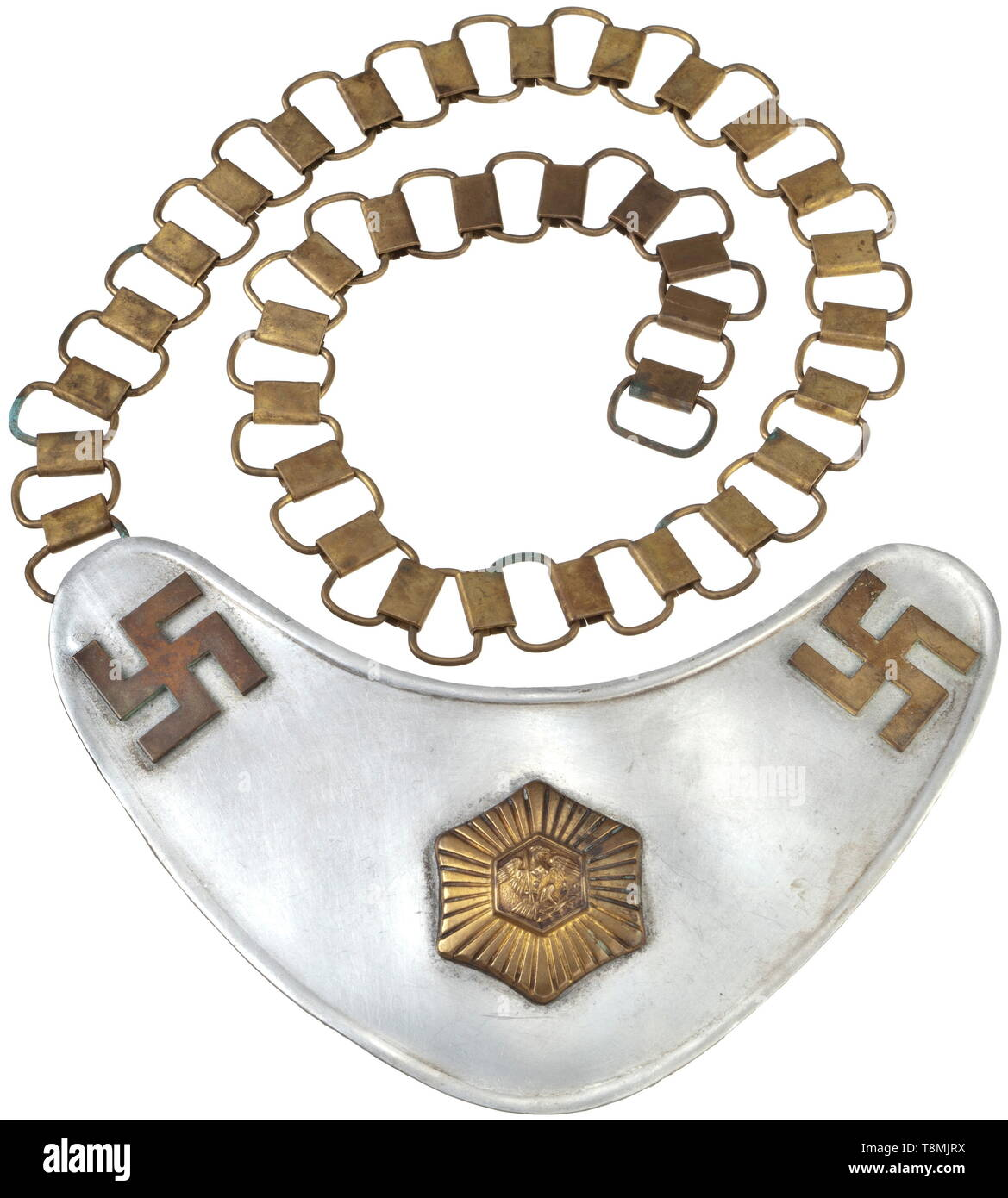 A gorget of the SA-Feldjägerkorps Kidney-shaped aluminium shield with gilt, screw affixed non-ferrous metal appliqués, centrally the star of the Prussian police and swastikas at the corners. The reverse with the original dark backing, at the left an RZM stamped bracket on which to hook the brass chain. Inexpertly cleaned. historic, historical, 20th century, 1930s, 1940s, storm battalion, stormtroopers, armed and uniformed branch of the NSDAP, organisation, organization, organizations, organisations, NS, National Socialism, Nazism, Third Reich, German Reich, Germany, fascism, Editorial-Use-Only - Stock Image