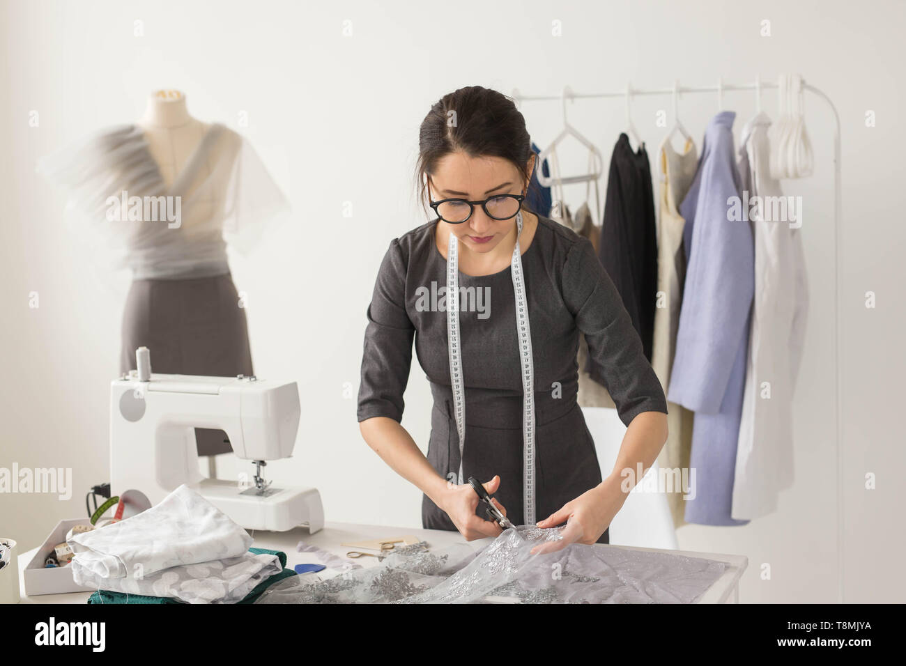 Dressmaker Fashion Designer And Tailor Concept Young Woman Designer Cuts Light Fabric Stock Photo Alamy