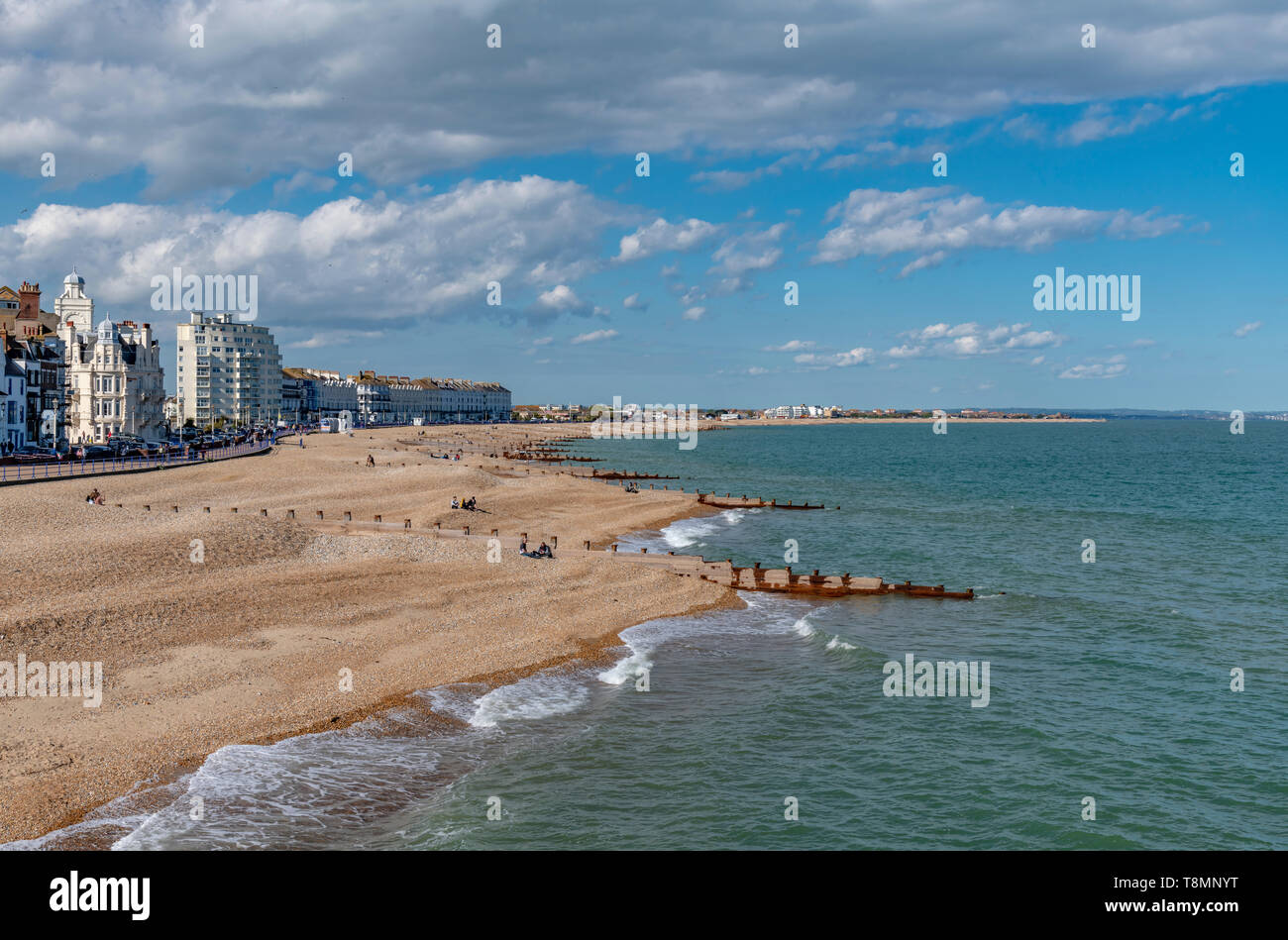 The sea front at Eastbourne showing the pebbled beach. Photo taken from Eastbourne Pier. Completed in 1872. Stock Photo