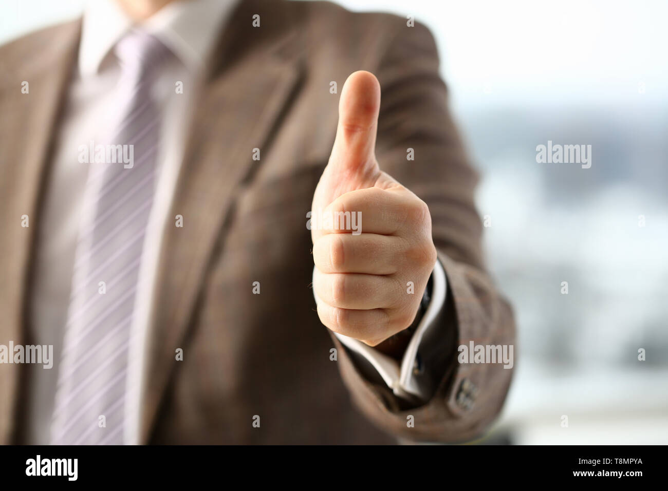 Male arm show OK or confirm during - Stock Image