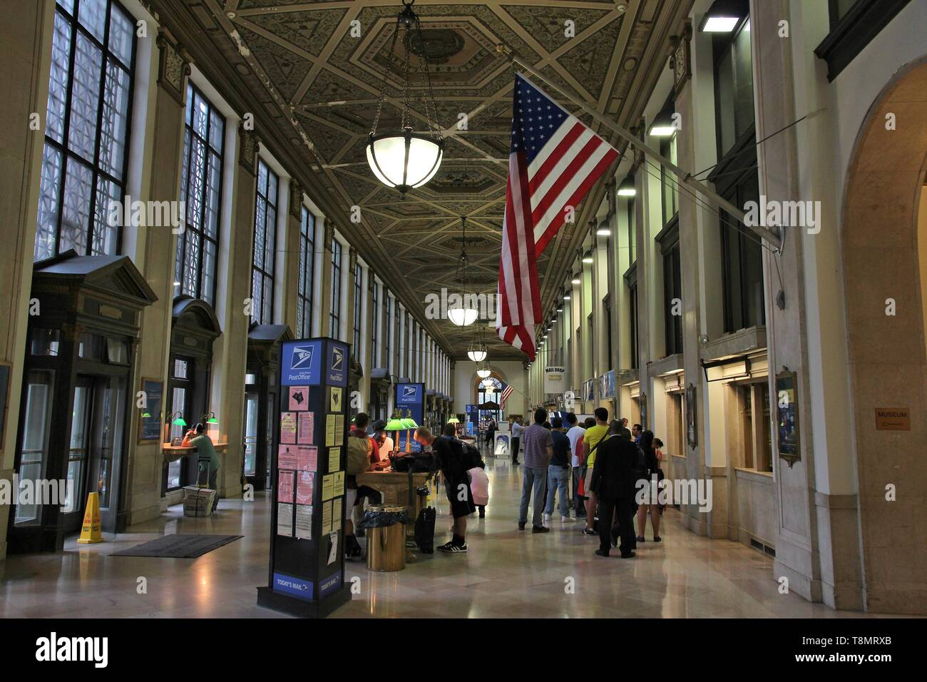 NEW YORK, USA - JULY 1, 2013: People visit famous James Farley Post Office in New York. It dates back to 1912 and is listed on National Register of Hi - Stock Image