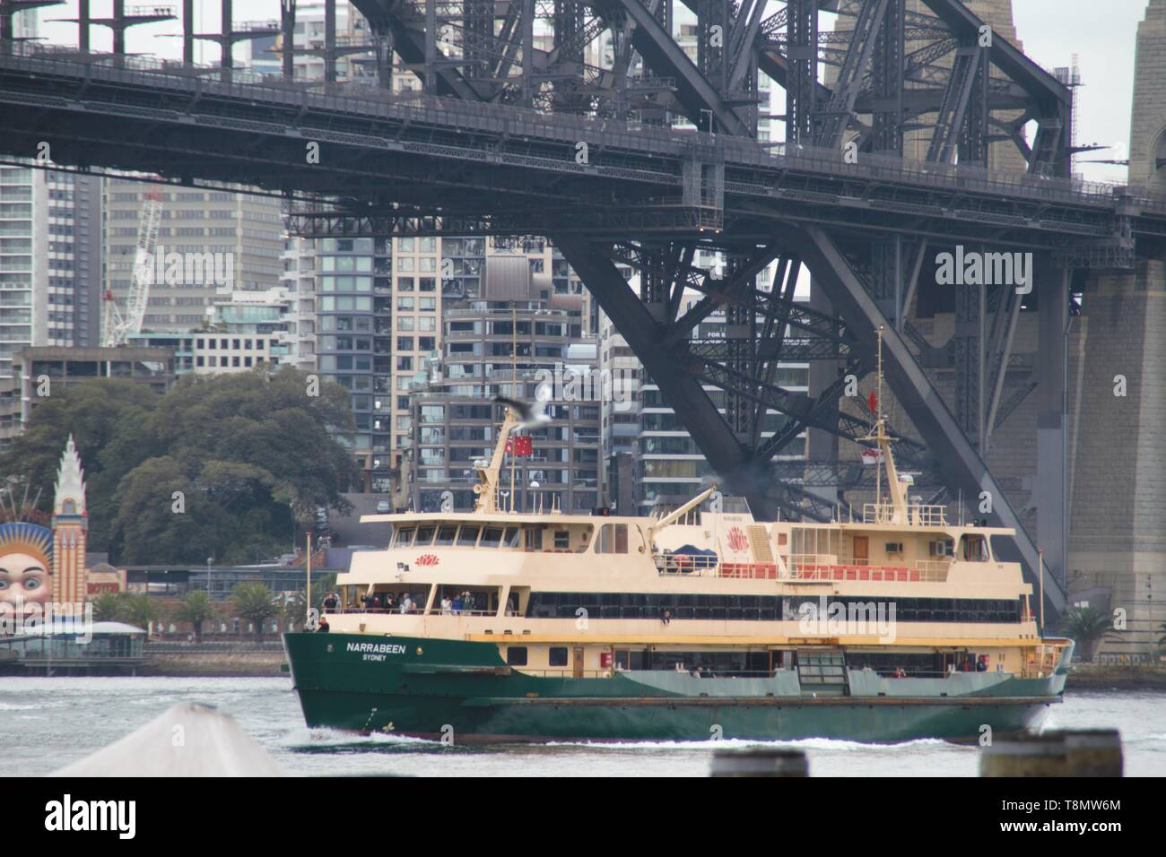 Big ferry boat under the Sydney harbour bridge - Stock Image