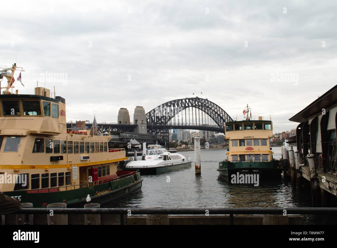 Beautiful view of the Sydney harbour bridge from the pier - Stock Image