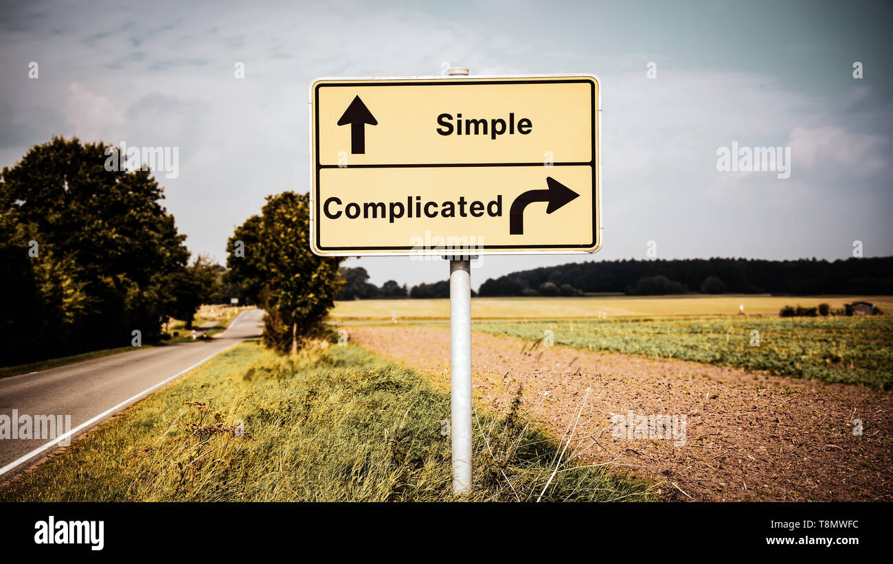 Street Sign the Direction Way to Simple versus Complicated - Stock Image