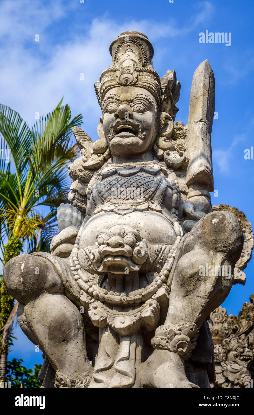 Guard statue on a temple entrance door in Ubud, Bali, Indonesia - Stock Image