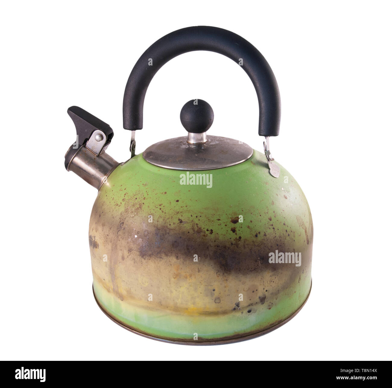 Kettle damaged by fire from a gas stove. Isolated on a white background - Stock Image