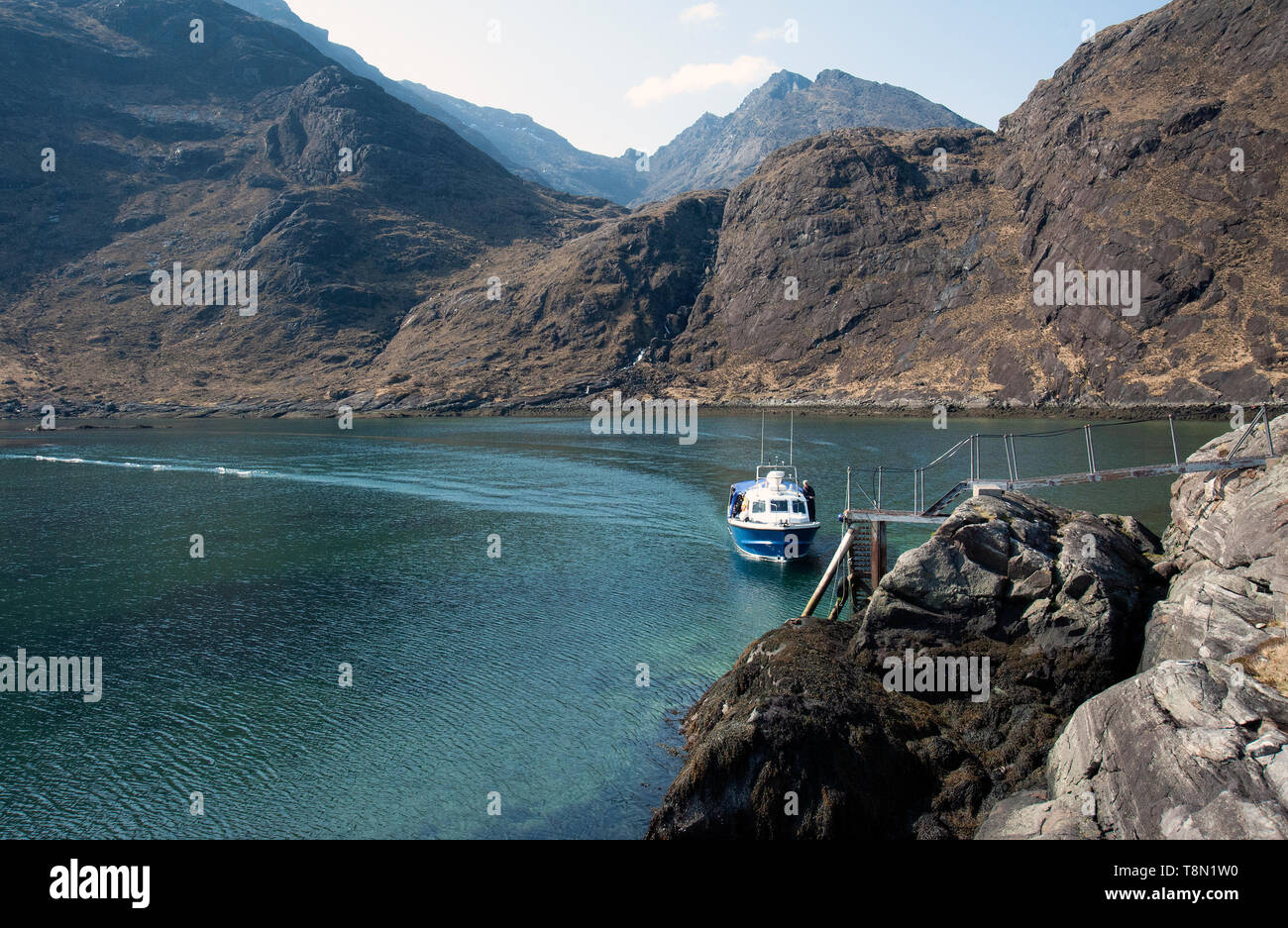 The Bella Jane passenger ferry disembarking hikers from Elgol to the remote Loch Coruisk on the Isle of Skye, in the Scottish Highlands. - Stock Image