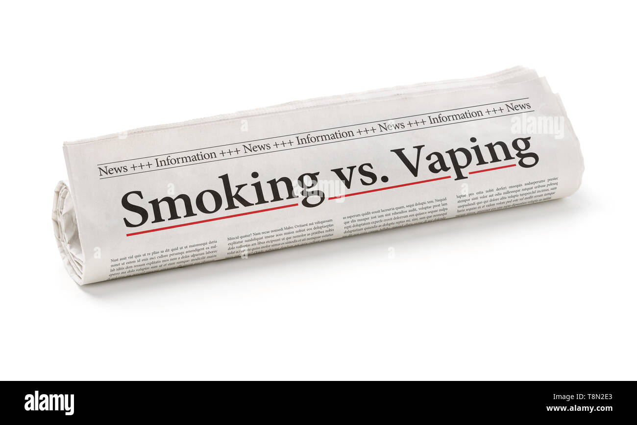 Rolled newspaper with the headline Smoking vs. vaping - Stock Image