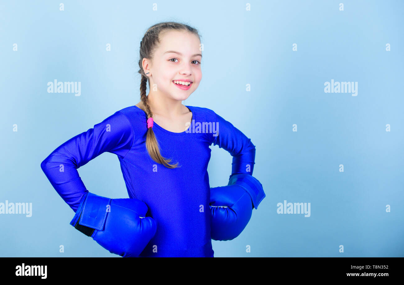 workout of small girl boxer. Fitness diet. energy health. punching knockout. Childhood activity. Sport success. sportswear fashion. Happy child sportsman in boxing gloves. Challenging herself. - Stock Image