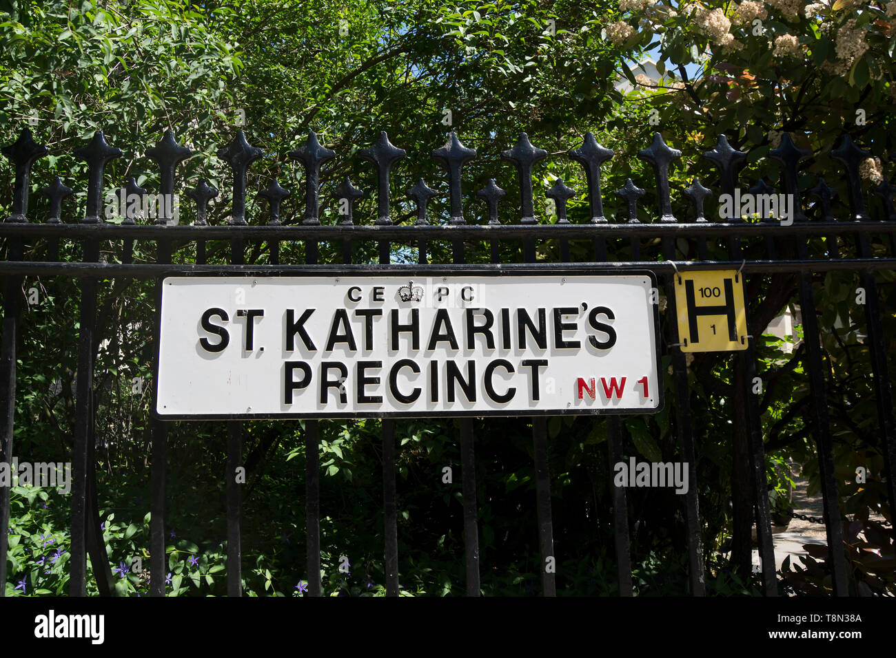 with a crown estates pavements commission logo, street name sign for st katharine's precinct , site of the danish lutheran church in  london, england - Stock Image