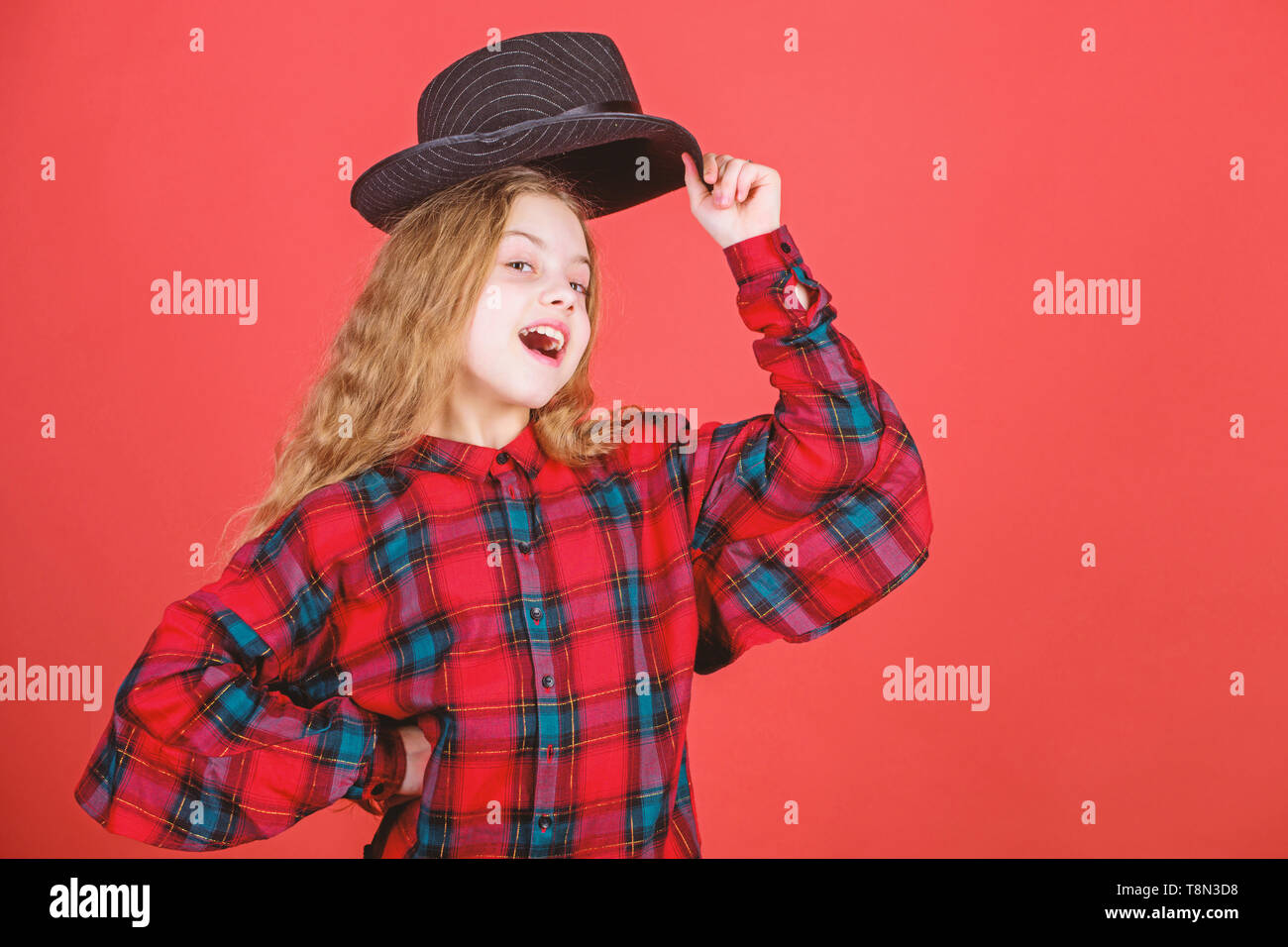 Acting school for children. Acting lessons guide children through wide variety of genres. Develop talent into career. Girl artistic kid practicing acting skills with black hat. Enter acting academy. - Stock Image