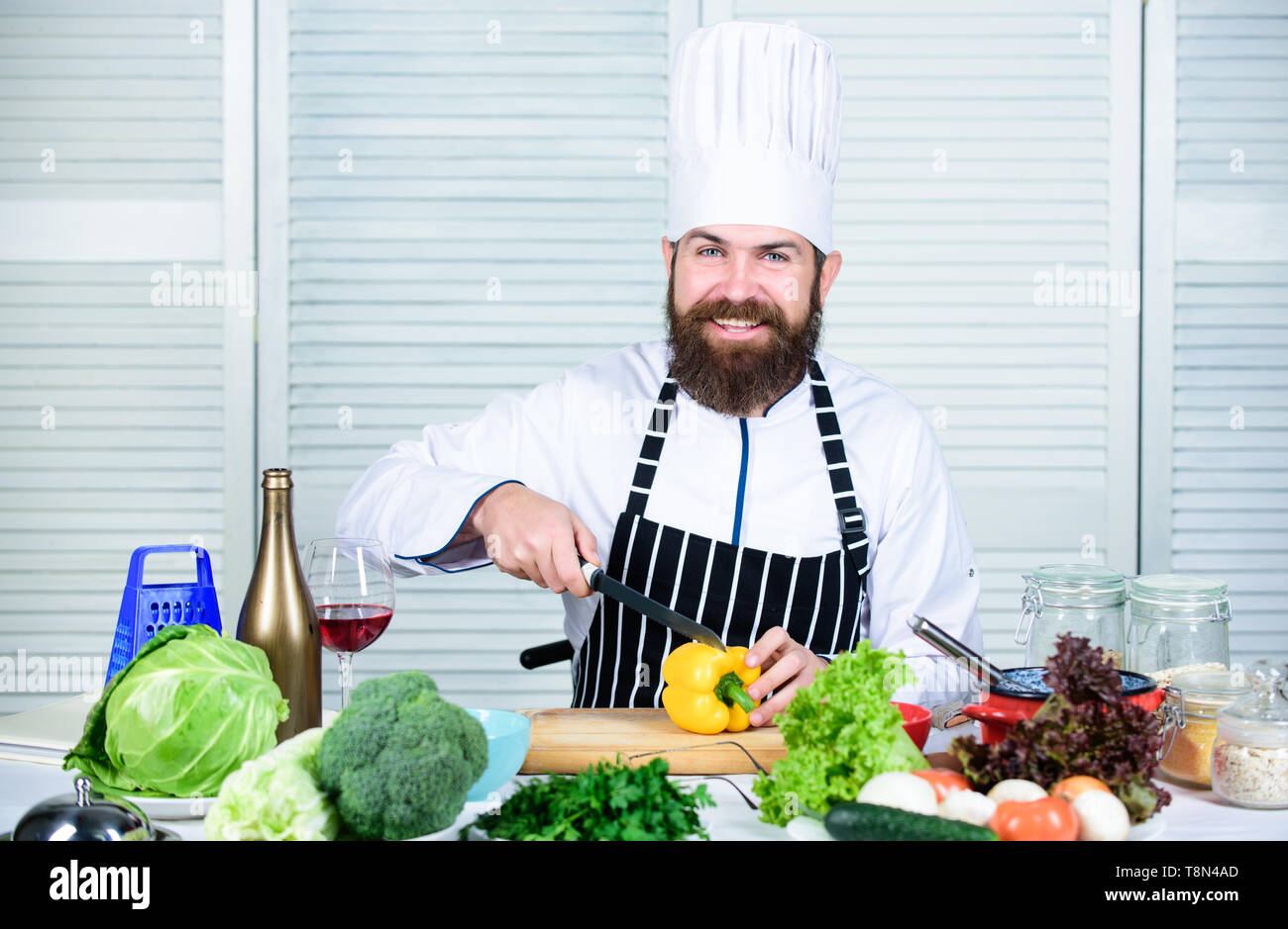 According to recipe. Prepare ingredients for cooking. Useful for significant amount of cooking methods. Basic cooking processes. Man master chef or amateur cooking healthy food. Chop ingredients. - Stock Image