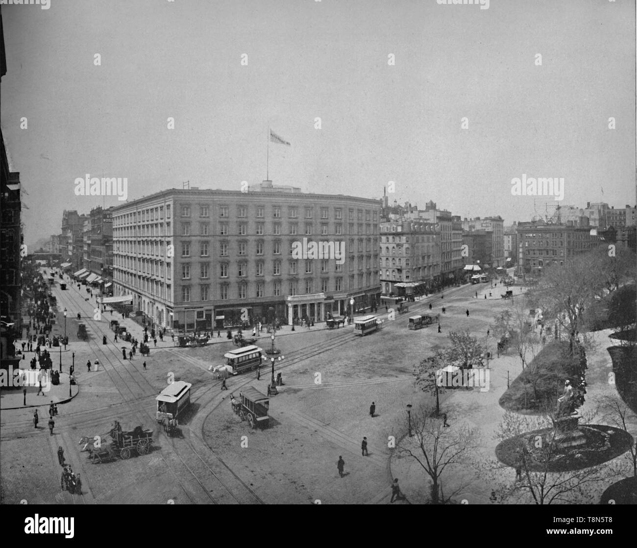 """'Fifth Avenue and Madison Square, New York', c1897. The Fifth Avenue Hotel, built 1856-59 by Amos Richards Eno at the intersection of Fifth Avenue and Broadway in Manhattan. Madison Square was named after James Madison, fourth President of the United States.  From """"A Tour Through the New World America"""", by Prof. Geo. R. Cromwell. [C. N. Greig & Co., London, c1897] Stock Photo"""