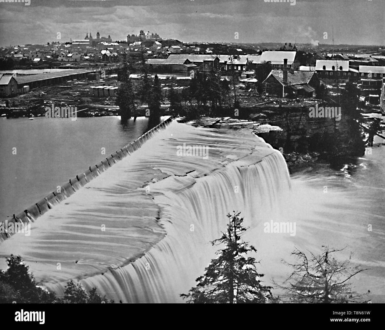"""'Ottawa, Canada, from Rideau Falls', c1897. Rideau Falls in Ottawa, Ontario, Canada, where the Rideau River falls into the Ottawa River. Named by the early French for their resemblance to a curtain, or rideau in French. From """"A Tour Through the New World America"""", by Prof. Geo. R. Cromwell. [C. N. Greig & Co., London, c1897] - Stock Image"""
