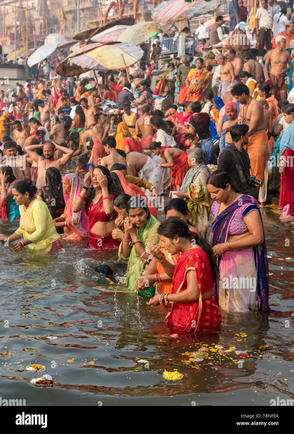 Hindu worshippers perform ritual bath and puja prayers in