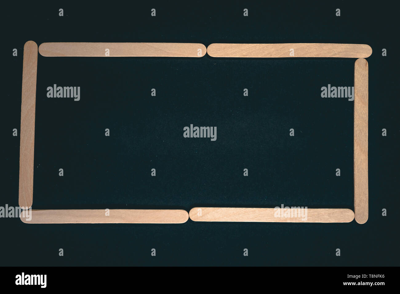 Numbers made of wood sticks isolated on black background - Stock Image