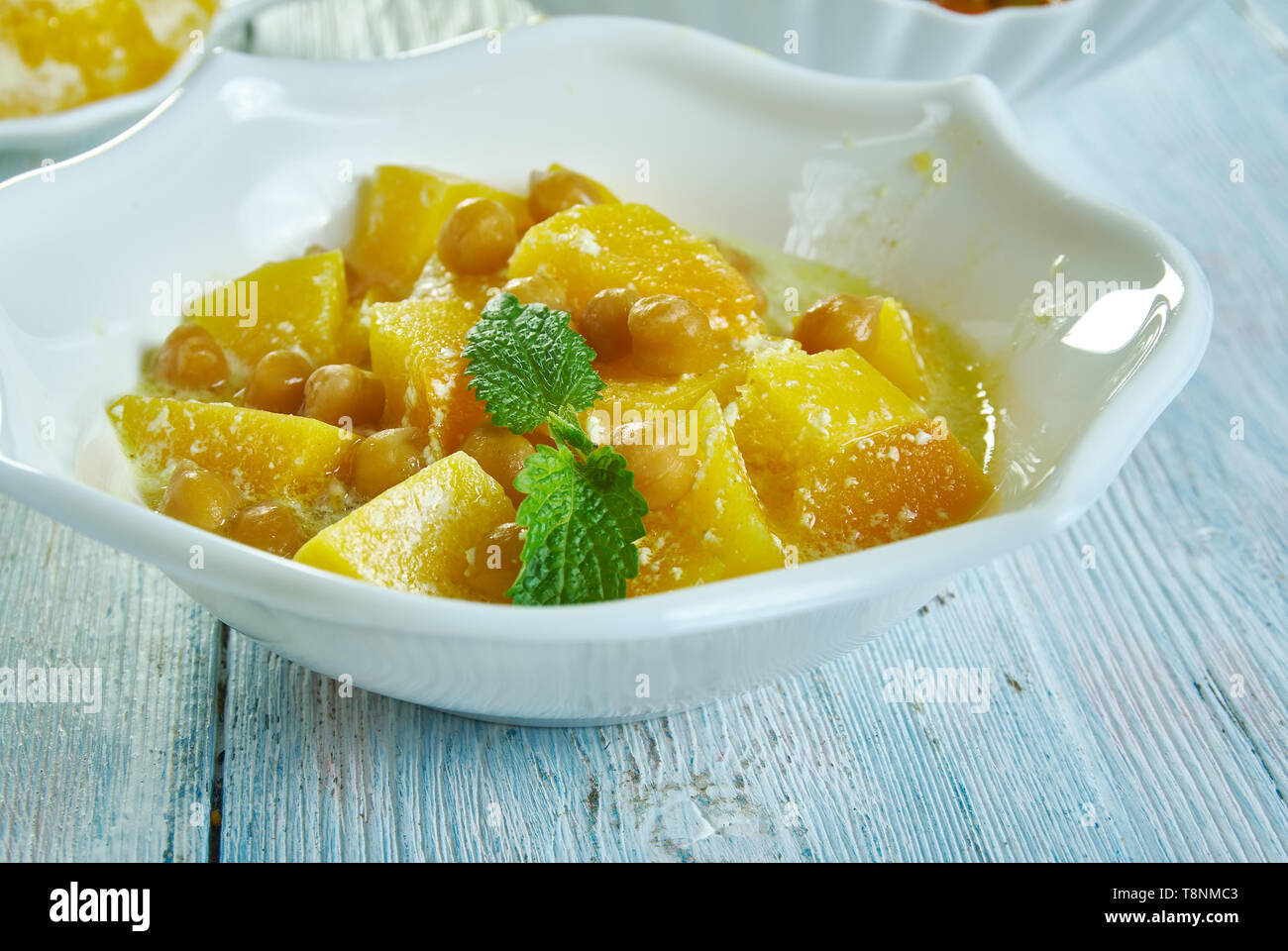Chickpea and squash coconut curry, great healthy, vegetarian midweek meal. - Stock Image
