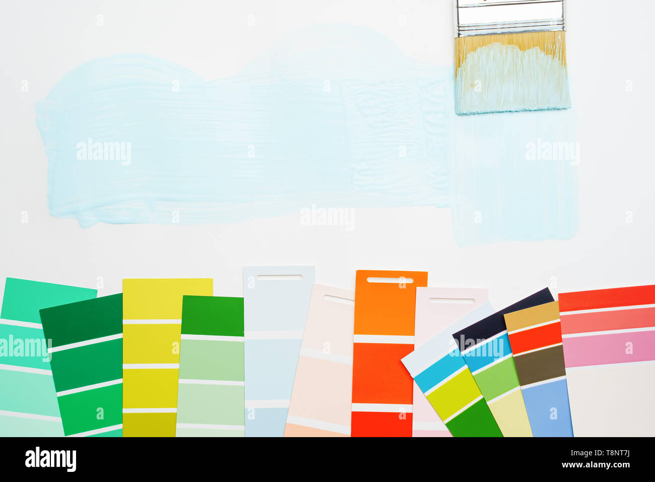 Picture of palette with blue and green, red colors, brush, on blank white background. - Stock Image