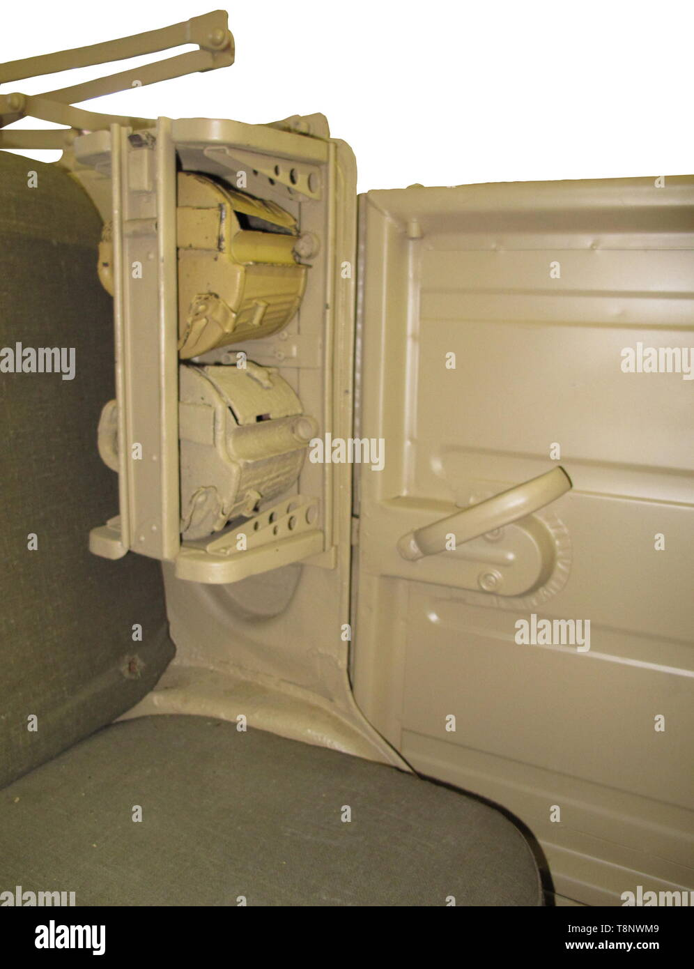 A VW-Kübelwagen type 82 Production year 1942. Roadworthy. Chassis no. 2-007969, structure no. 7911. Unrestored condition, modifications to ensure further drivability. Chassis with dotted chassis number. Gearbox, front axle, rear axle, steering gear with KDF mark (early type with aluminium lid) and all four shock absorbers original. Engine (30 HP) and braking system replaced (hydraulic brake refitted) as well as floor pans. 16-inch rims riveted, tyres replaced. Original body: All nameplates original as well as the originally welded in rear panel (, Additional-Rights-Clearance-Info-Not-Available Stock Photo