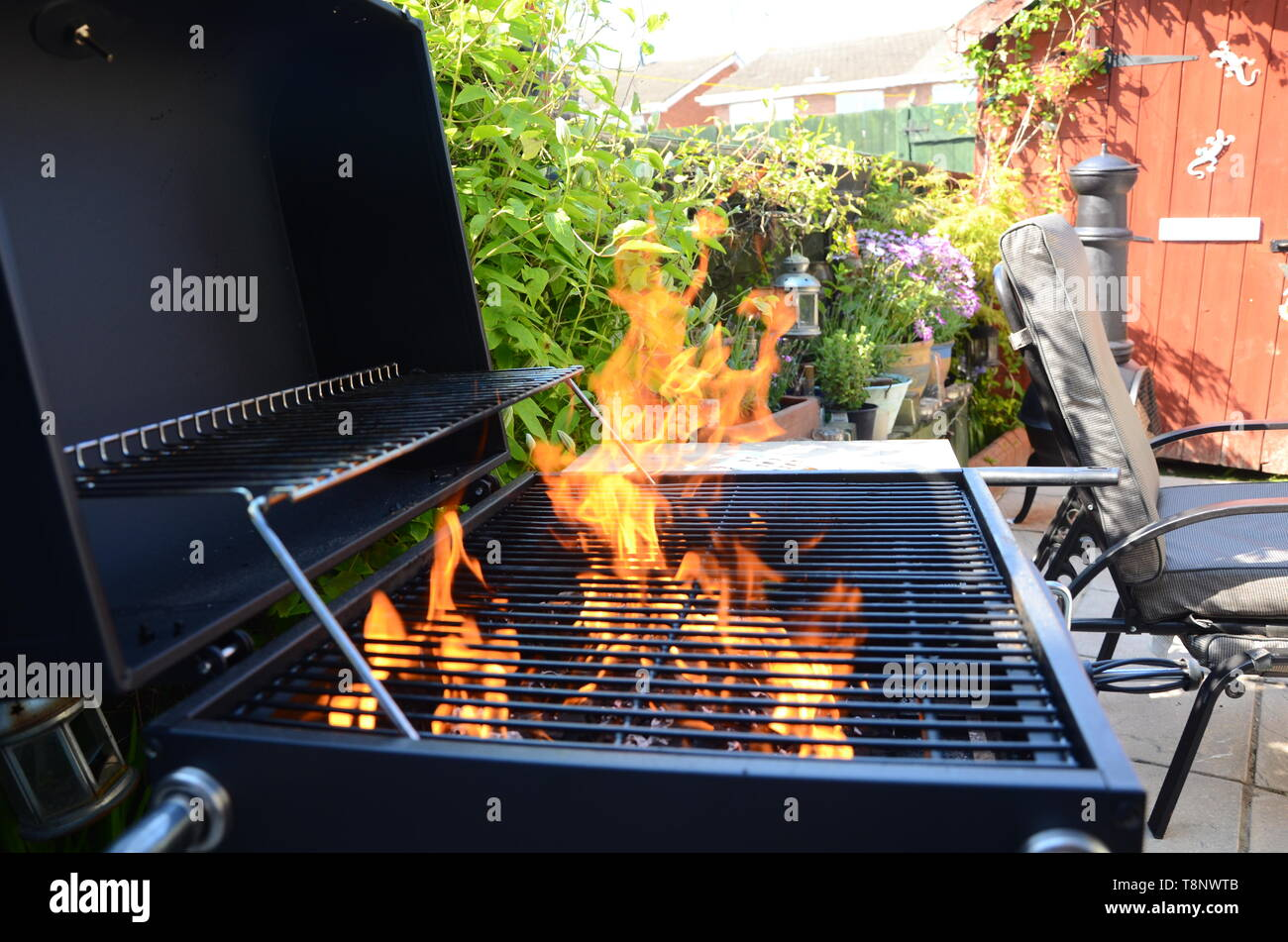 garden barbecue, lighter fuel, home fire safety - Stock Image