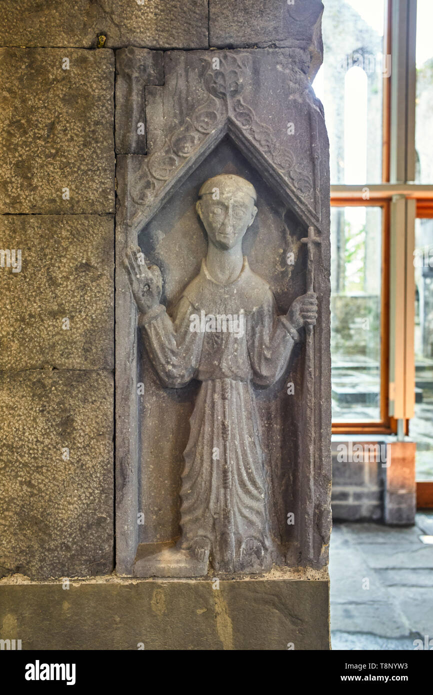 Representation of St Francis on a stone carving in Ennis Abbey, County Clare, Ireland - Stock Image