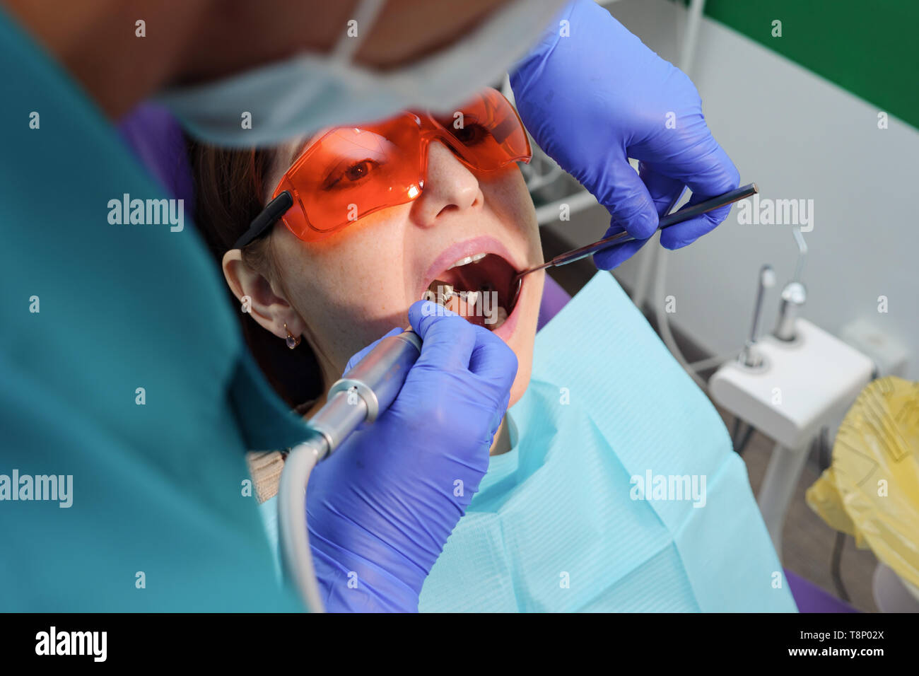 Young girl on preventive examination in dental chair at the dentist. Teeth care concept. - Stock Image