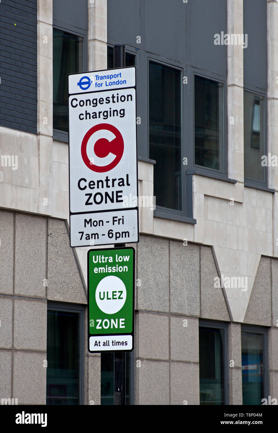 Congestion charging sign together with Ultra Low Emission Zone sign near Tower Bridge, London England. UK - Stock Image