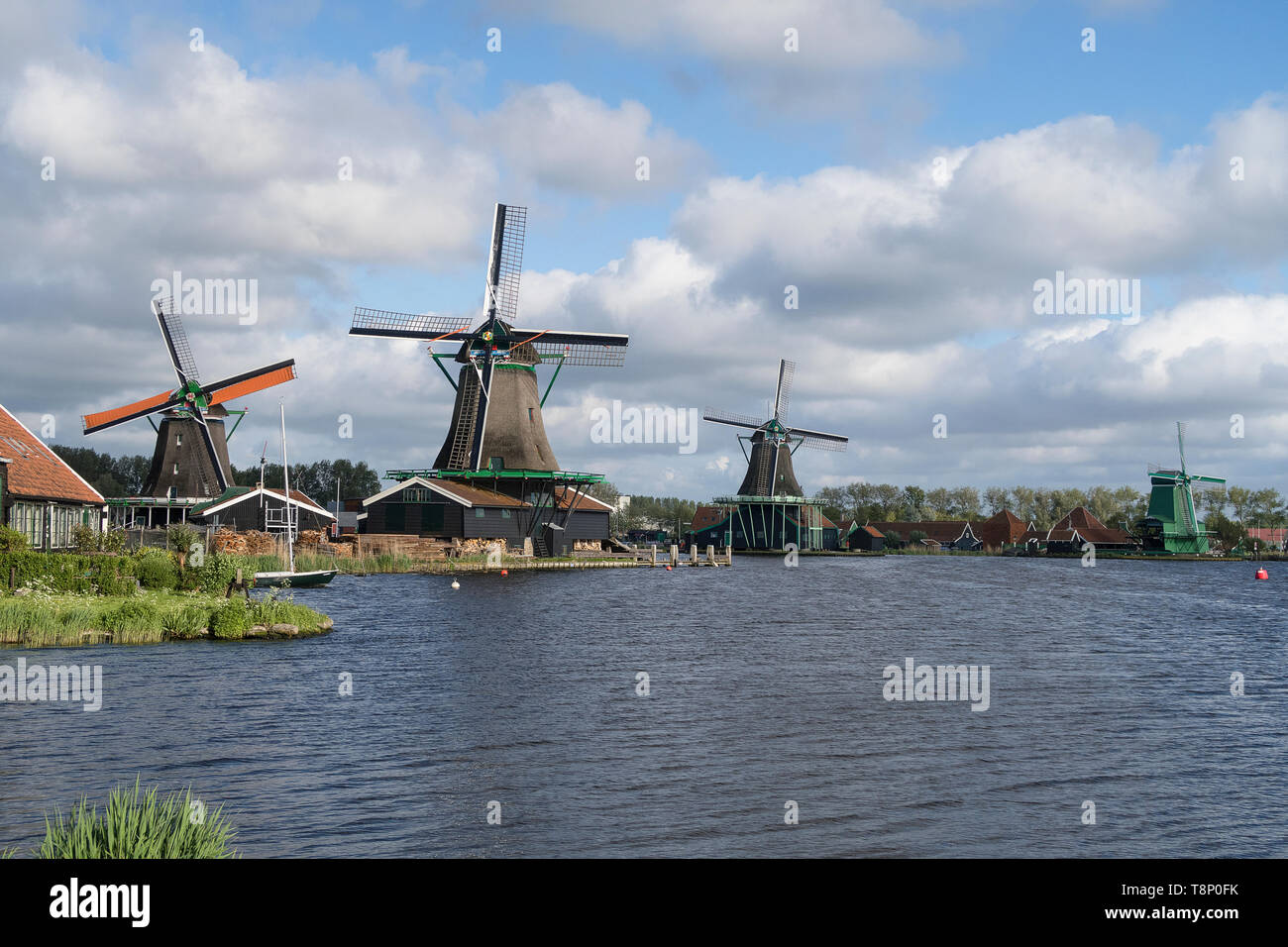 Windmills of the Zaanse Schans a populair historic tourist village in the Netherlands - Stock Image