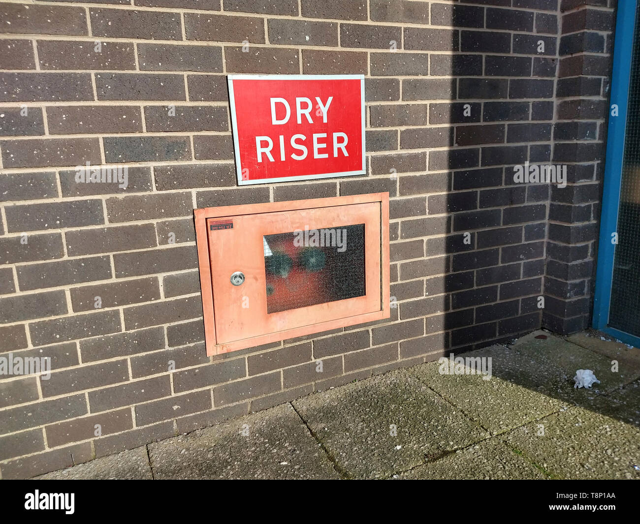 Dry riser inlet at base of multi story car park - Stock Image
