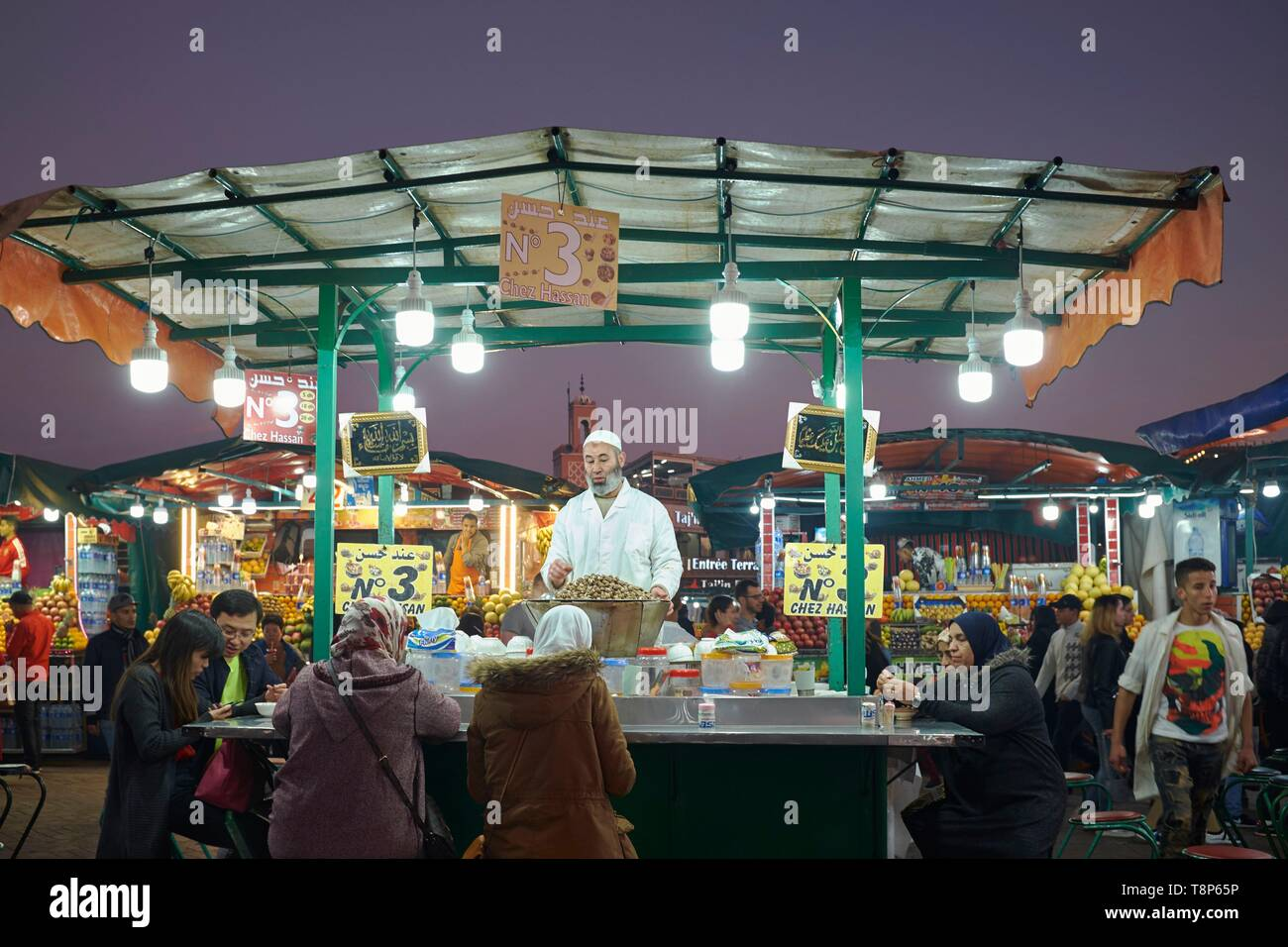 Morocco, High Atlas, Marrakesh, Imperial City, medina listed as World Heritage by UNESCO, Jemaa El Fna square at dusk, restaurants street stalls Stock Photo