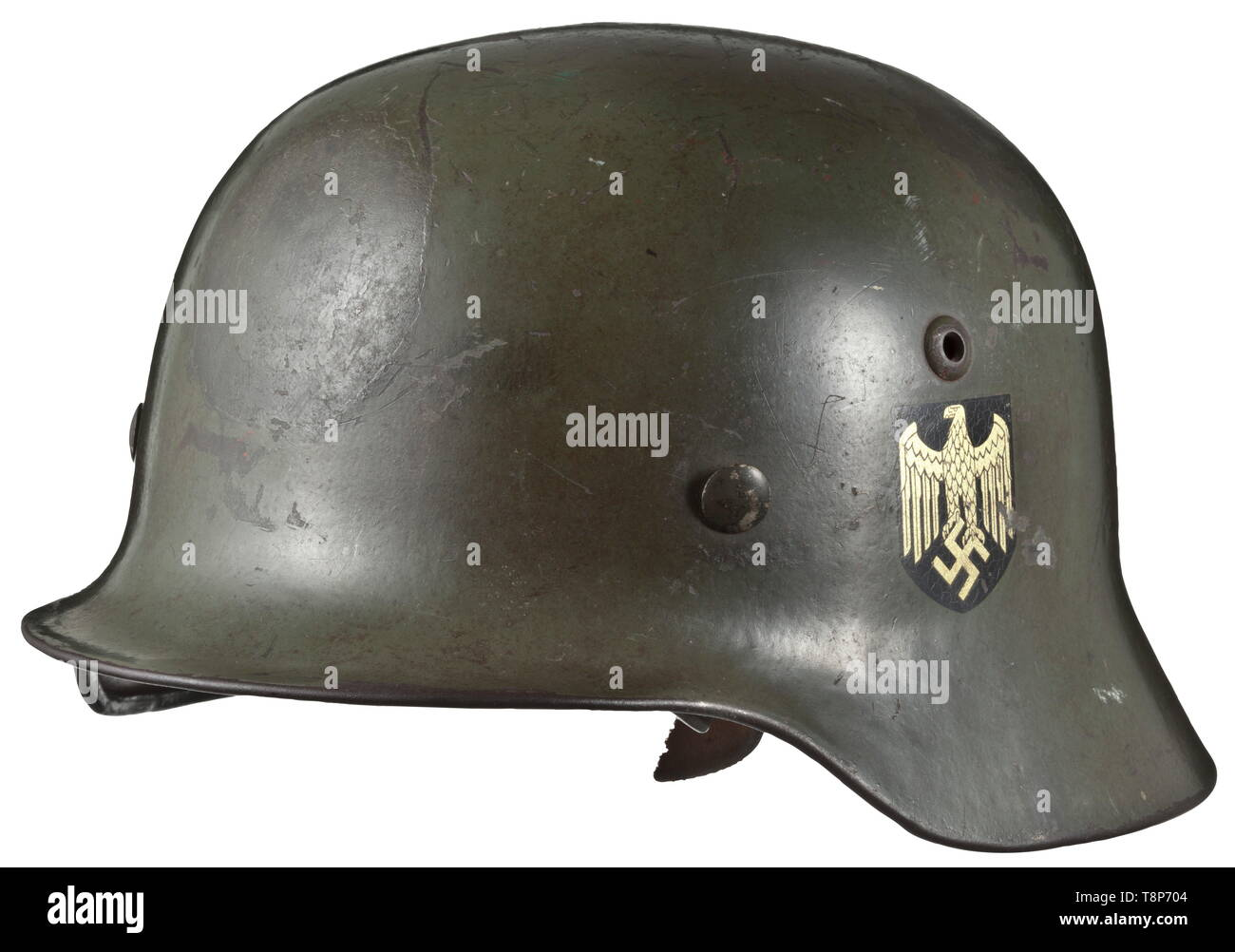 A steel helmet M 35 with both decals Steel shell with 'apple-green' basic lacquer, however over-painted to suit front requirements. Both decals almost fully preserved. Shell stamped 'SE 64' and '526' as well as wearer's name 'Uffz. Eisgruber'. Complete with inner lining and chin strap (stamped but torn). Signs of age and usage. historic, historical, army, armies, armed forces, military, militaria, 20th century, Editorial-Use-Only - Stock Image