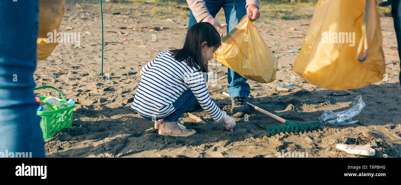 Volunteers cleaning the beach Stock Photo
