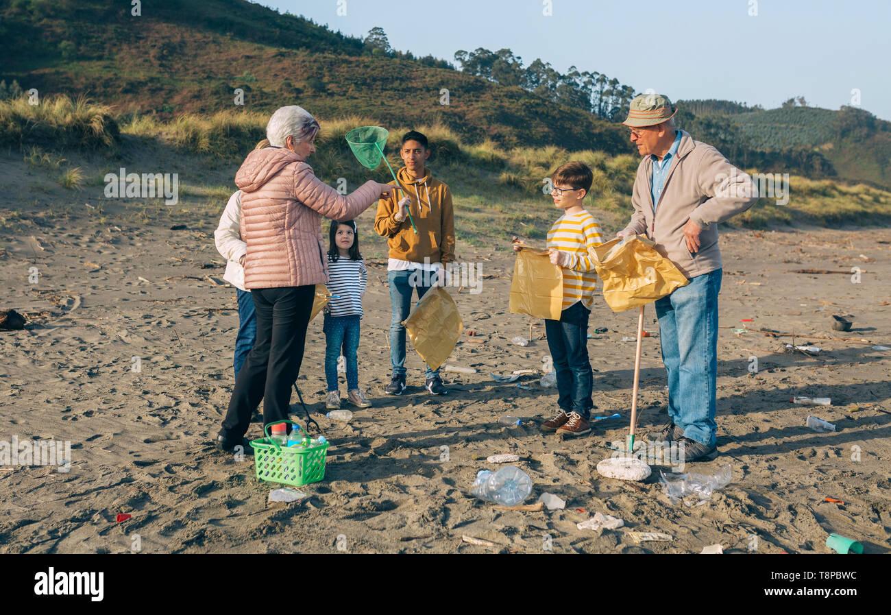 Volunteers preparing to clean the beach - Stock Image